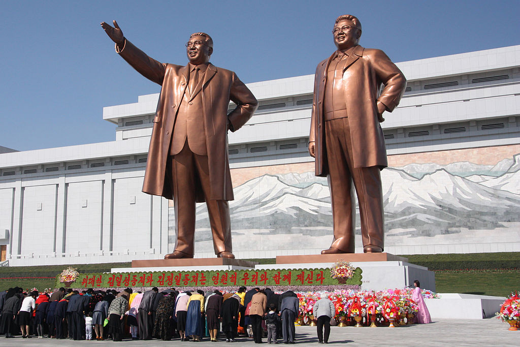 """The statues of Kim Il Sung and Kim Jong Il on Mansu Hill in Pyongyang (april 2012)"" by J.A. de Roo - Own work. Licensed under CC BY-SA 3.0 via Wikimedia Commons - https://commons.wikimedia.org"