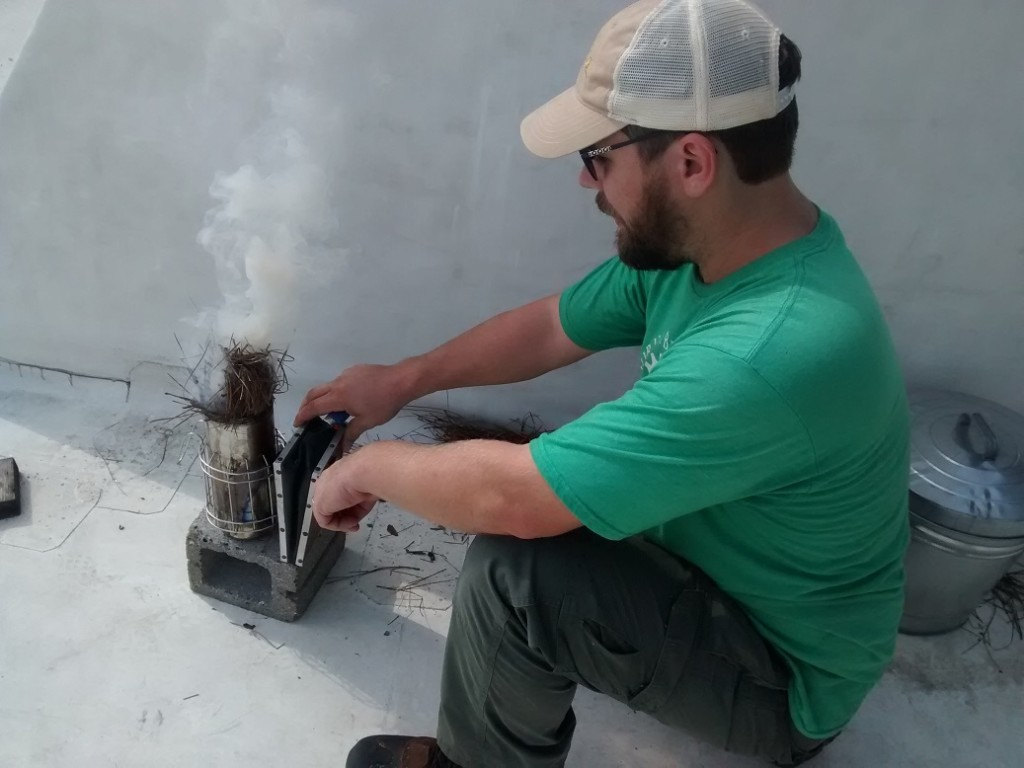 Smoke helps in handling the bees - this system has been used since invented