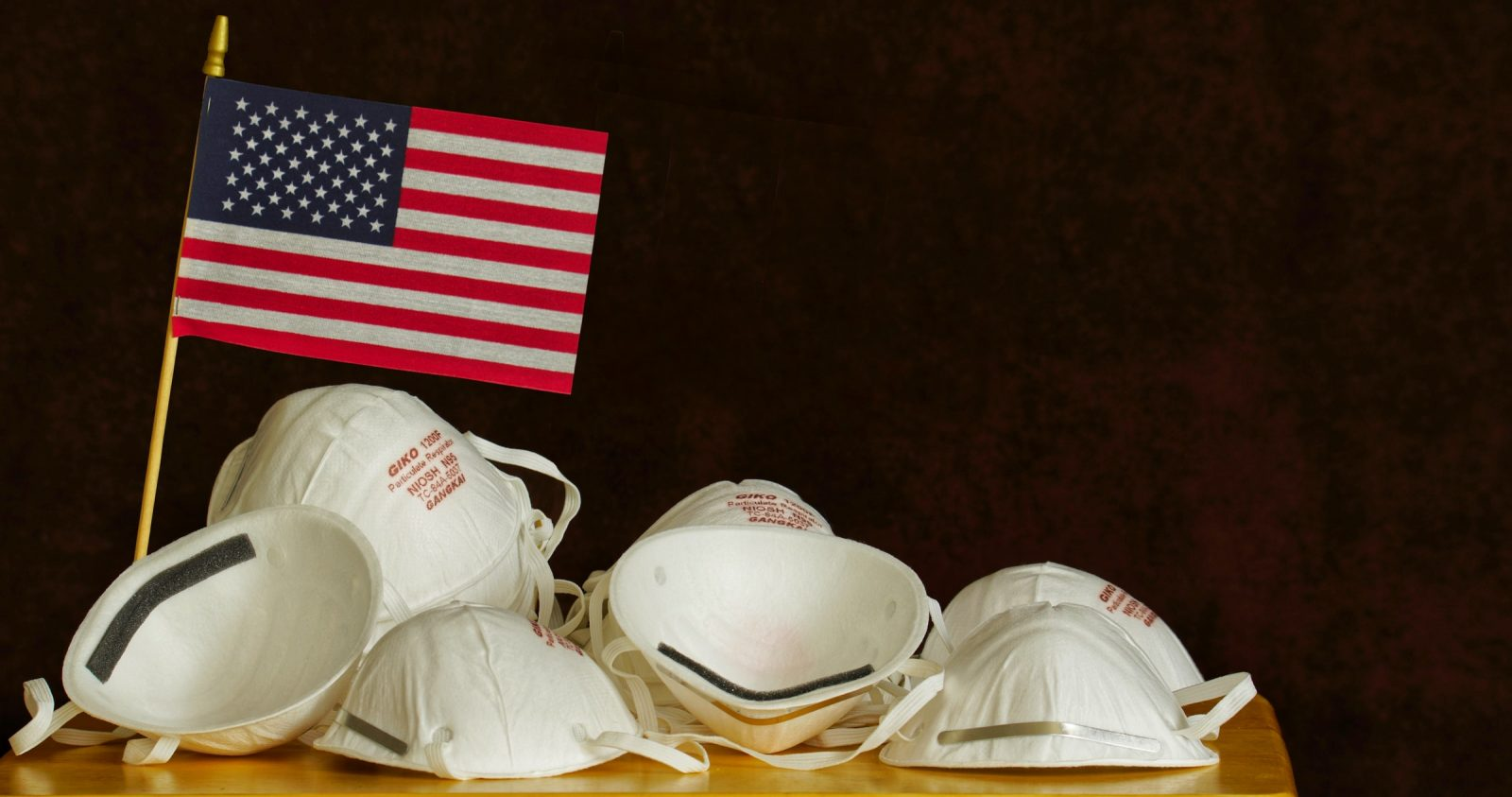 masks and a USA flag